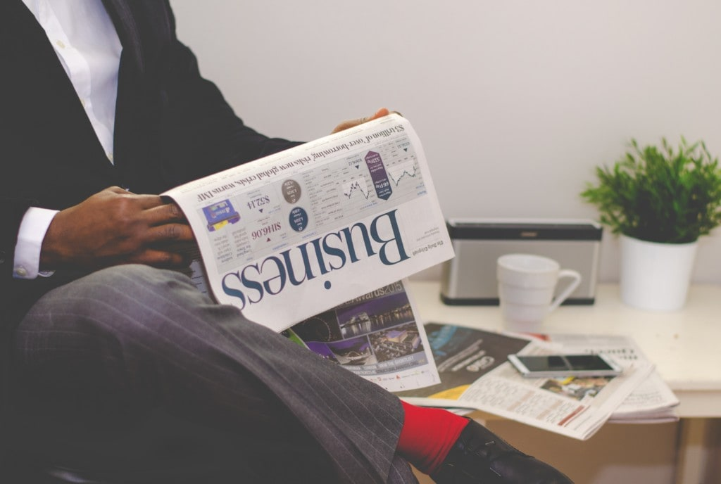 man reading business newspaper