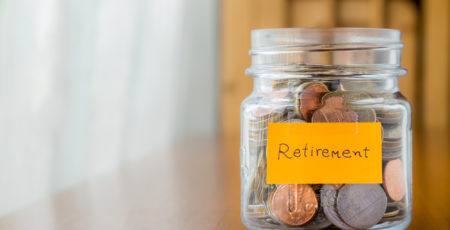 Coins in a jar being saved for Retirement